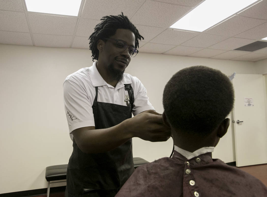 Samna Ryan (center), 10, has his hair cut by Anthony Brown (left) in the barber shop at LoveLife Family Services in Las Vegas, Wednesday, July 12, 2017. Gabriella Angotti-Jones Las Vegas Review-Jo ...