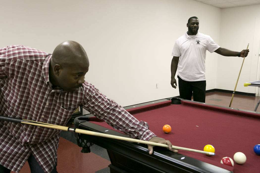 LoveLife's founder, Clevonne Funches, right, plays pool with a friend at LoveLife Family Services in Las Vegas, Wednesday, July 12, 2017. Gabriella Angotti-Jones Las Vegas Review-Journal @gabriell ...