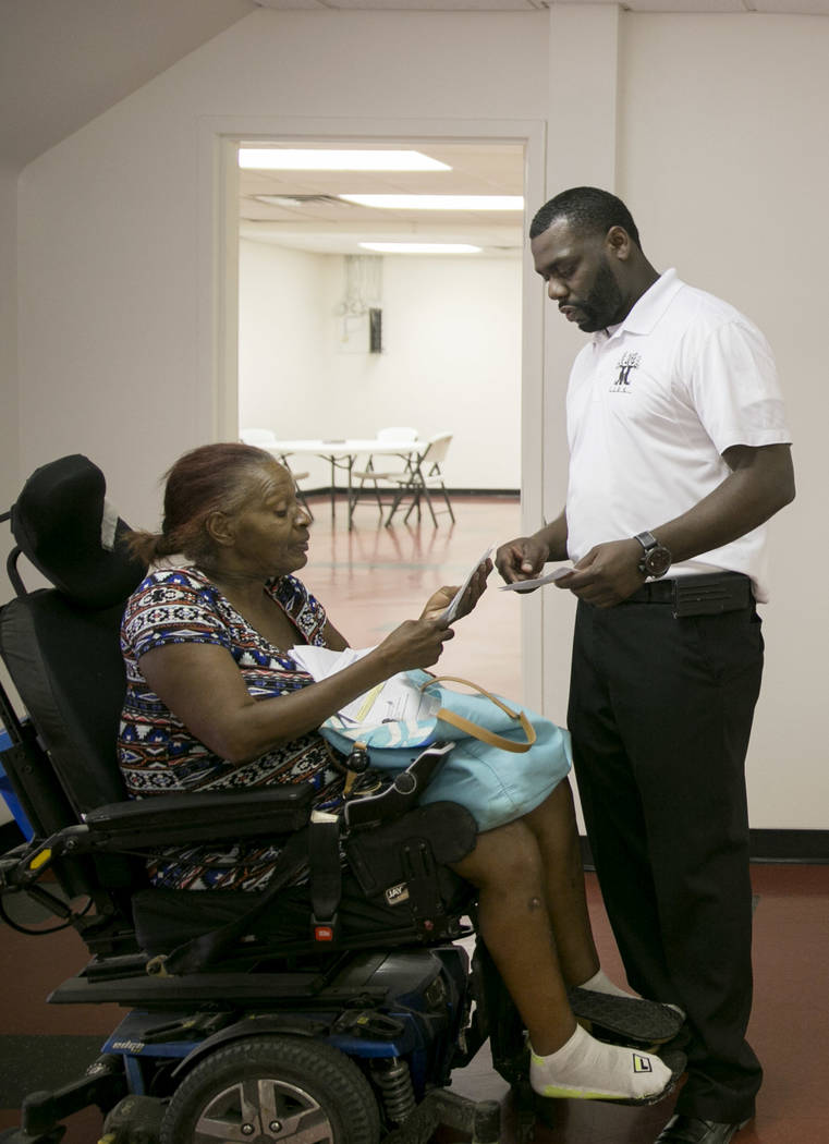 LoveLife's founder, Clevonne Funches, right, helps a client with her bills at LoveLife Family Services in Las Vegas, Wednesday, July 12, 2017. Gabriella Angotti-Jones Las Vegas Review-Journal @gab ...