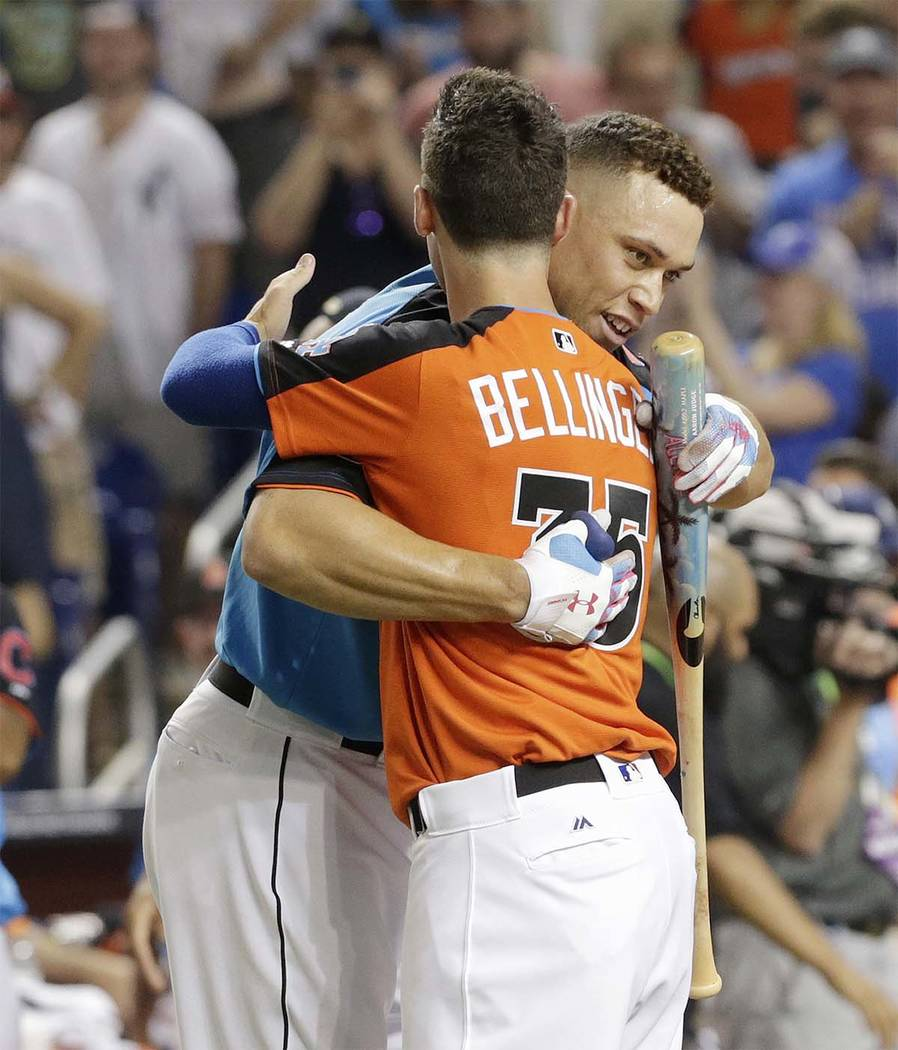 New York Yankees' Aaron Judge is hugged by Los Angeles Dodgers' Cody Bellinger (35) during the MLB baseball All-Star Home Run Derby, Monday, July 10, 2017, in Miami. (Lynne Sladky/AP)