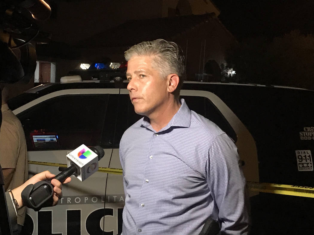 Metropolitan Police Department homicide Lt. Dan McGrath talks to the media about an apparent murder-suicide on the 10300 block of Numaga Road in Las Vegas, July 10, 2017. (Rachel Crosby/Las Vegas  ...