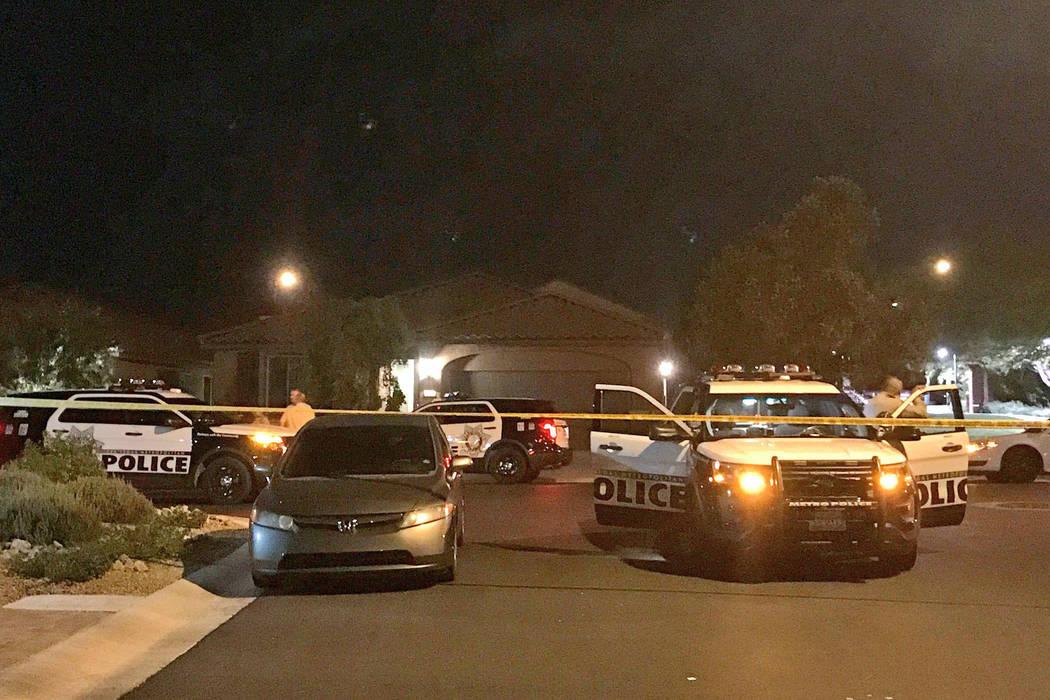 Police investigate an apparent murder-suicide on the 10300 block of Numaga Road in Las Vegas, July 10, 2017. (Rachel Crosby/Las Vegas Review-Journal)