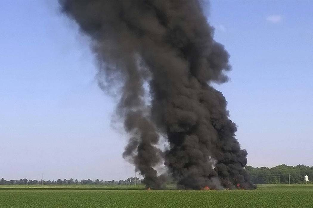 Smoke and flames rise into the air after a military transport airplane crashed in a field near Itta Bena, Mississippi, on Monday, July 10, 2017, killing at leasgt 16 people. (Jimmy Taylor via AP)