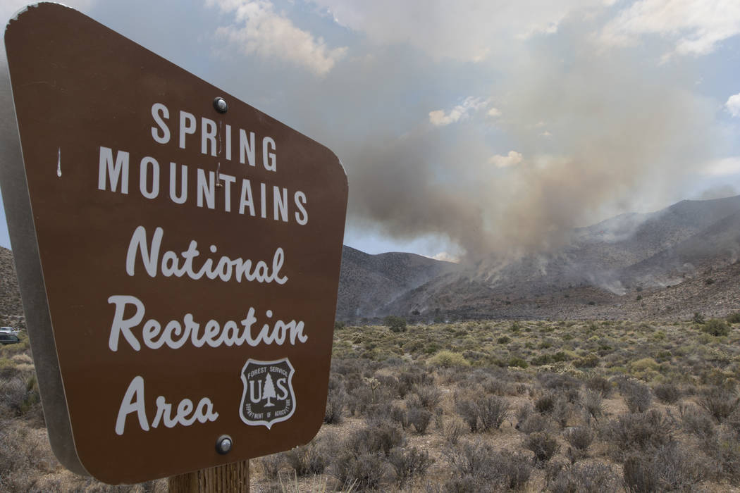 U.S. Forest Service officials say a wildfire burning on the western side of Mount Potosi should be fully contained sometime Friday.  (Richard Brian/Las Vegas Review-Journal) @vegasphotograph