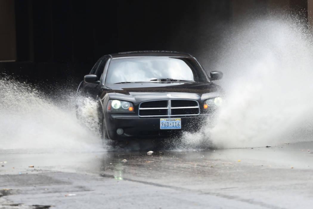 Motorist navigates through a flooded street on Bonanza Road during a quick rain shower on Tuesday, July 11, 2017, in Las Vegas. (Bizuayehu Tesfaye/Las Vegas Review-Journal) @bizutesfaye
