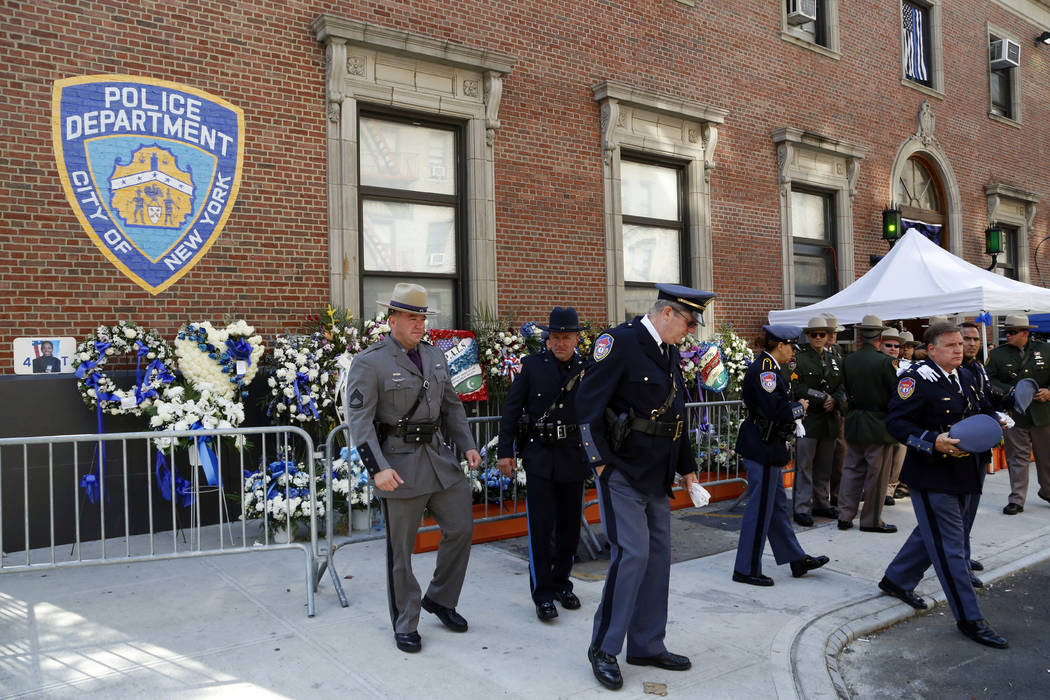 Police officers with the Westchester County, Fishkill, and New York State Police pay their respects for New York police officer Miosotis Familia, Tuesday, July 11, 2017, outside the 46th Precinct  ...