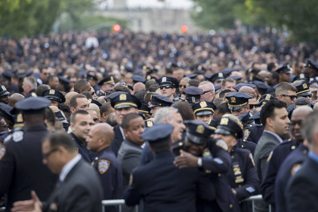 Police officers congregate for the funeral service for slain New York City police officer Miosotis Familia, Tuesday, July 11, 2017, at the World Changers Church in the Bronx borough of New York. F ...