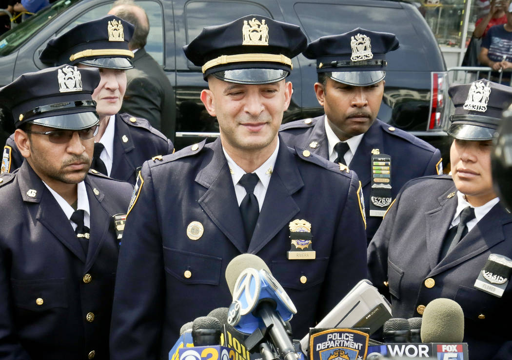Inspector Philip Rivera, center, commander of the 46th Precinct, address media outside the wake for slain police officer Miosotis Familia, Monday July 10, 2017, in New York. Familia was shot and k ...