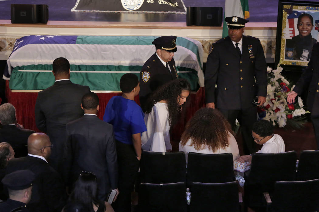 The family of New York City Police officer Miosotis Familia arrives for her funeral at the World Changers Church, in The Bronx borough of New York, Tuesday, July 11, 2017. (Richard Drew/AP, Pool)