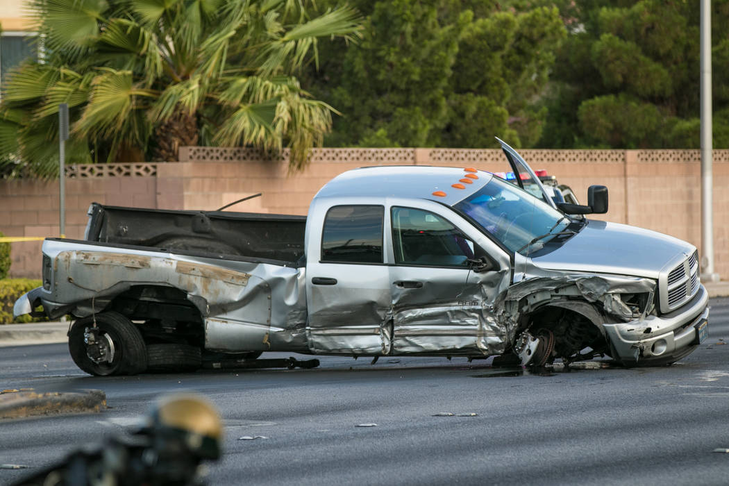 Las Vegas police investigate a fatal crash involving a stolen pickup truck near Charleston Boulevard and Fort Apache Road on Wednesday, July 5, 2017. (Morgan Lieberman/Las Vegas Review-Journal)
