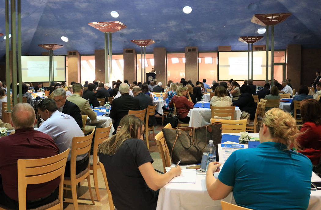 People attending the Office of Workforce Innovations' conference listen to the event's opening remarks at the Clark County Government Center, Friday, July 14, 2017. Gabriella Benavidez Las Vegas R ...