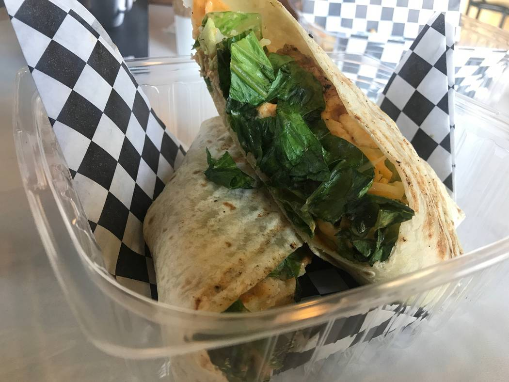 A chicken siracha wrap is served on July 7 at Chess House Cafe, 6430 W. Lake Mead Blvd. #160. (Kailyn Brown/View) @KailynHype