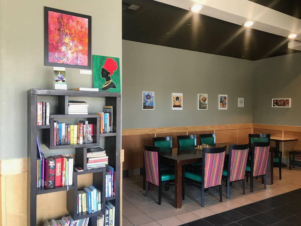 A book shelf and art work are displayed on July 7 at Chess House Cafe, 6430 W. Lake Mead Blvd. #160. (Kailyn Brown/View) @KailynHype