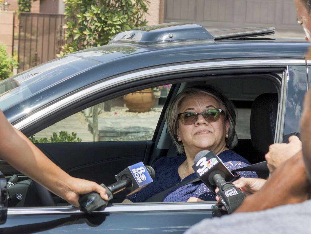 Domestic Violence victim Sylvia Rico shares her deep regards to news outlets at the home of John Lunetta, 10337 S. Numaga Road, where the bodies were found Monday night  in Las Vegas, Tuesday, Jul ...