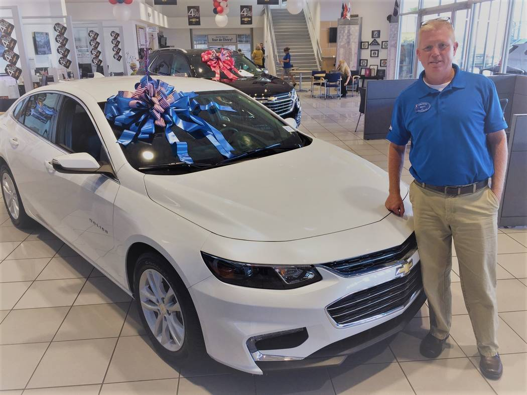 Findlay Chevrolet Findlay Chevrolet veteran sales consultant Matt Masluk is seen with a 2017 Chevrolet Malibu at the dealership in the southwest valley.