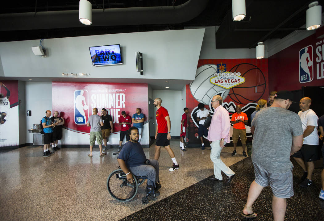 Shon Darby, center, moves through the concourse during the NBA Summer League at the Cox Pavilion in Las Vegas on Wednesday, July 12, 2017. Chase Stevens Las Vegas Review-Journal @csstevensphoto