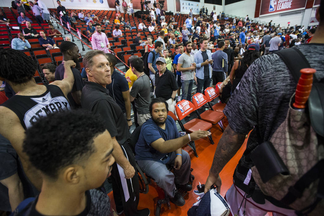 Shon Darby, center, reaches out to greet players between games at the NBA Summer League at the Cox Pavilion in Las Vegas on Wednesday, July 12, 2017. Chase Stevens Las Vegas Review-Journal @csstev ...