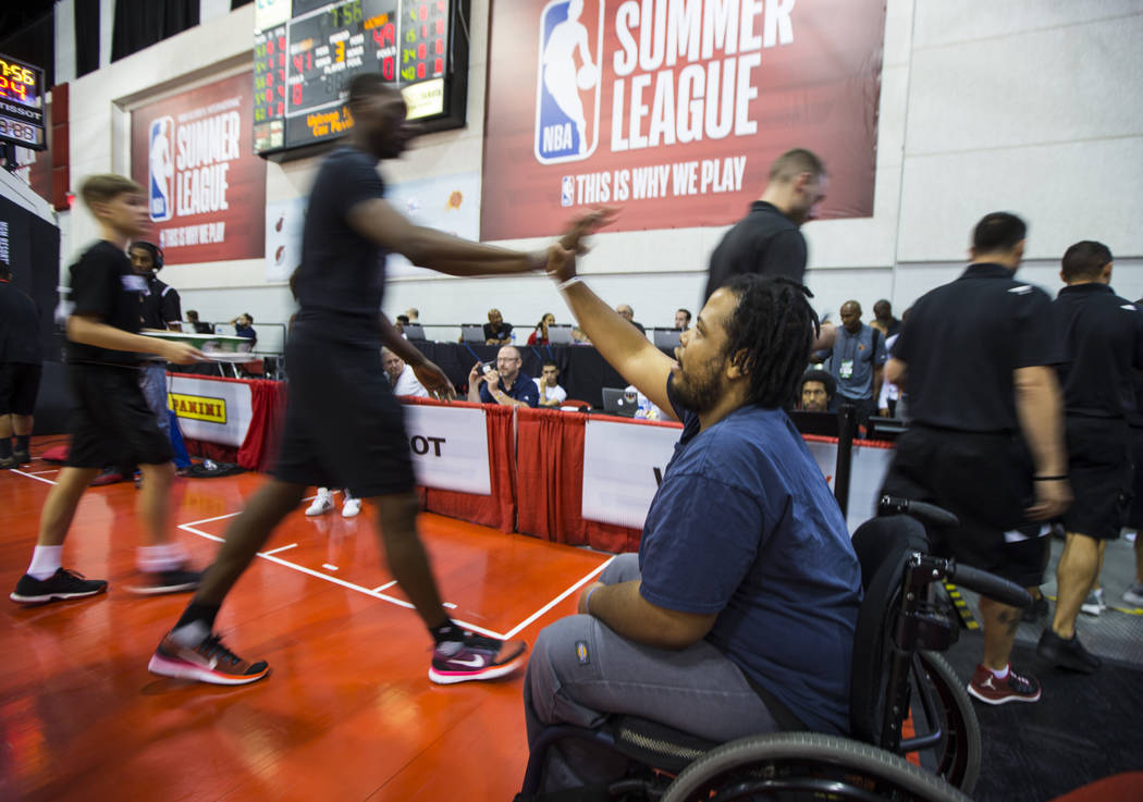 Shon Darby high fives Miami Heat players and staff during halftime at the NBA Summer League at the Cox Pavilion in Las Vegas on Wednesday, July 12, 2017. Chase Stevens Las Vegas Review-Journal @cs ...