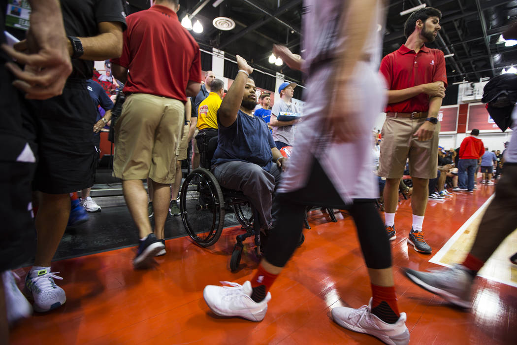 Shon Darby high fives players walking off the court at the NBA Summer League at the Cox Pavilion in Las Vegas on Wednesday, July 12, 2017. Chase Stevens Las Vegas Review-Journal @csstevensphoto