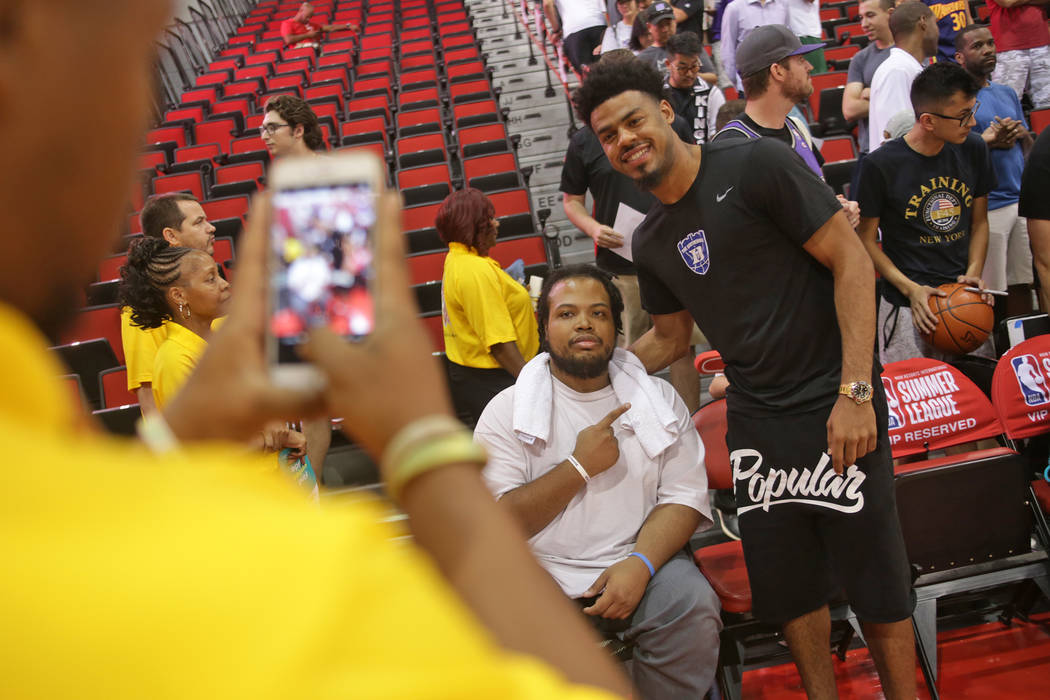 Shon Darby, left, poses for a photo with Quinn Cook of the New Orleans Pelicans at the NBA Summer League on Sunday, July 9, 2017, at the Cox Pavilion in Las Vegas. Darby has been a fixture at the  ...