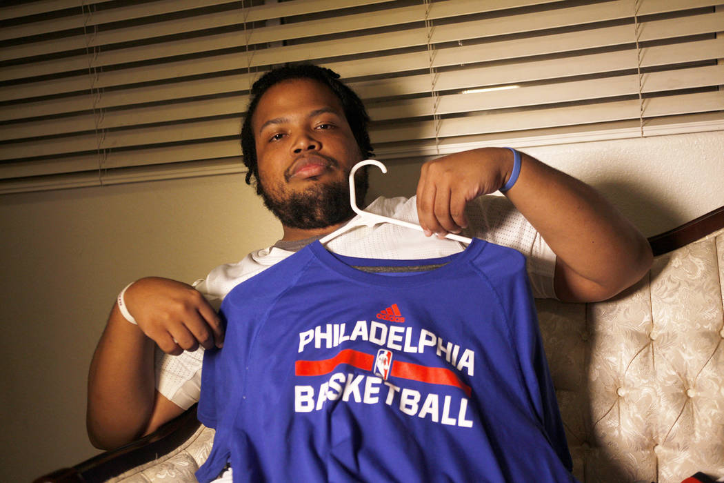 Shon Darby-McConnell shows off a Philadelphia 76ers jersey on Thursday, July 14, 2017, at his home in Las Vegas. Rachel Aston Las Vegas Review-Journal @rookie__rae