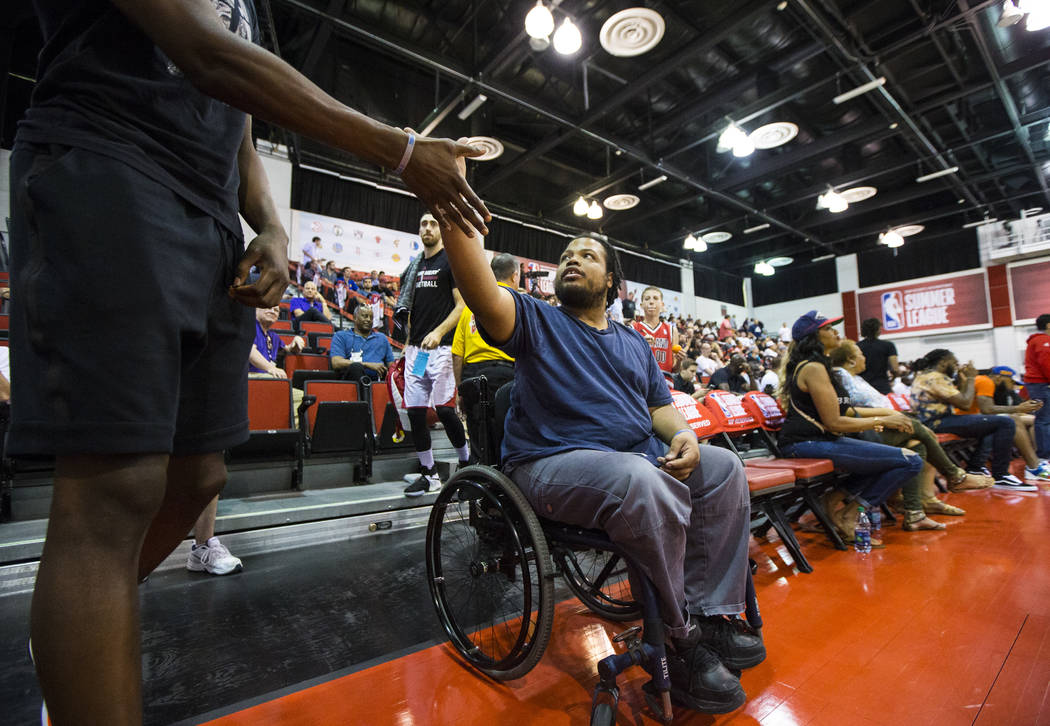 Shon Darby, center, greets Miami Heat's Bam Adebayo ahead of a game at the NBA Summer League at the Cox Pavilion in Las Vegas on Wednesday, July 12, 2017. Chase Stevens Las Vegas Review-Journal @c ...