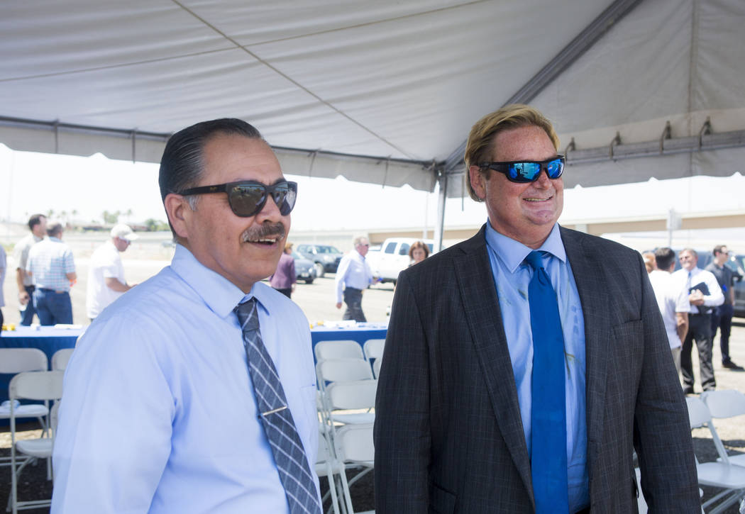 The Nevada Department of Transportation director Rudy Malfabon, left, and NDOT spokesman Tony Illia talk during a celebration to mark the opening of the Centennial Bowl flyover bridge linking west ...