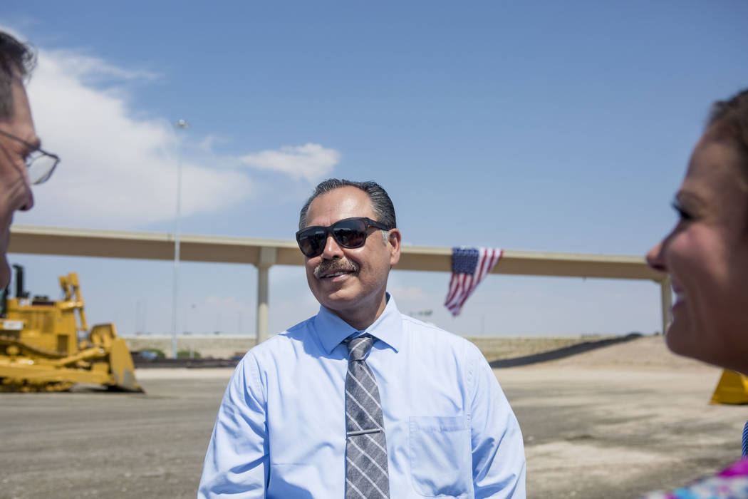 The Nevada Department of Transportation director Rudy Malfabon celebrates the opening of the Centennial Bowl flyover bridge linking westbound 215 Beltway and southbound U.S. Highway 95 in northwes ...