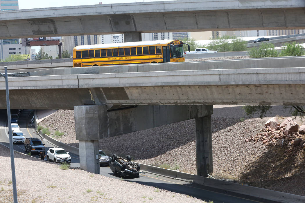 Overturned car on the Martin Luther King Boulevard exit from northbound U.S. Highway 95 and Interstate 15, Tuesday, July 11, 2017. (Michael Quine/Las Vegas Review-Journal) @Vegas88s