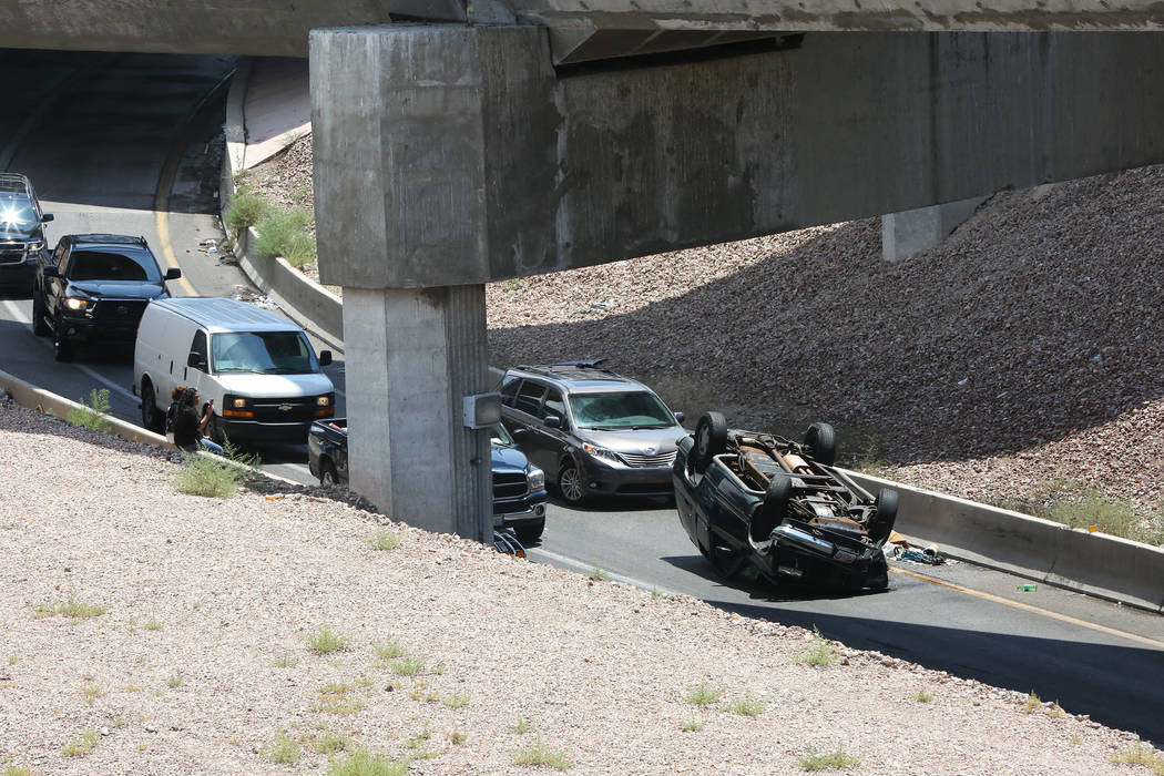 Overturned car on the Martin Luther King Boulevard exit from northbound Interstate 15, Tuesday, July 11, 2017. (Michael Quine/Las Vegas Review-Journal) @Vegas88s