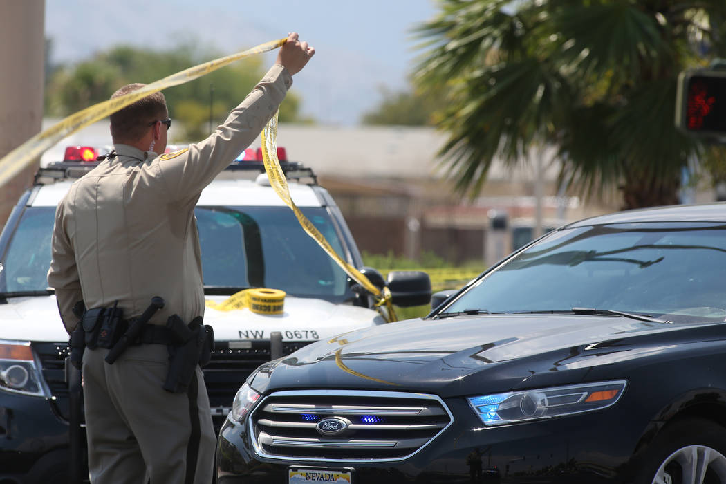 An officer lets a car pass police tape on North Rancho Drive between North Jones Boulevard and West Craig Road where an officer involved shooting occurred on Tuesday, July 11, 2017, in Las Vegas.  ...