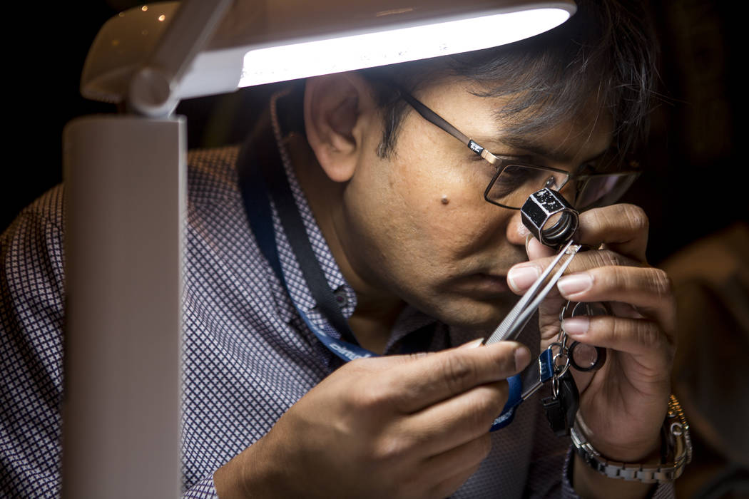 Alpesh Shah of Di-Moksh Diam Inc. examines a diamond at Pawn Expo at The Mirage on Wednesday, July 12, 2017.  Patrick Connolly Las Vegas Review-Journal @PConnPie