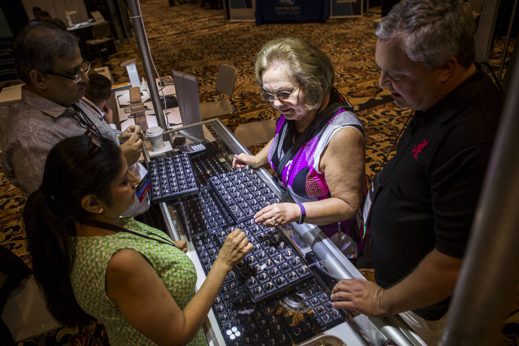 Rosemary and Jeffery Hipps browse a selection of diamonds from Shri Diamond Inc. at Pawn Expo at The Mirage on Wednesday, July 12, 2017.  Patrick Connolly Las Vegas Review-Journal @PConnPie