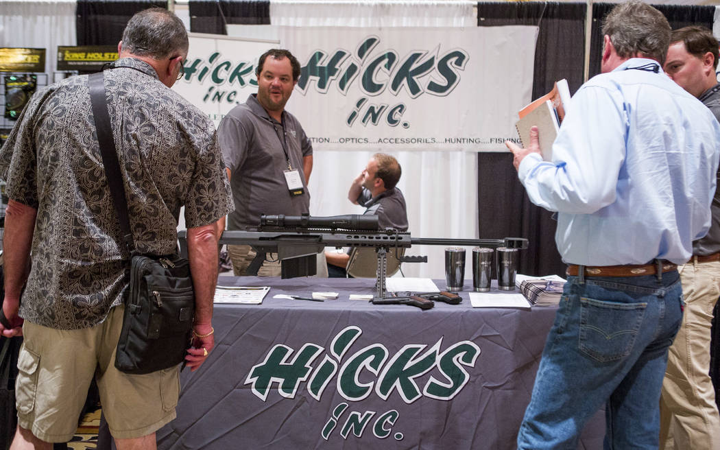 Jack Crosby of Hicks Inc., center left, talks to visitors to their booth at Pawn Expo at The Mirage on Wednesday, July 12, 2017.  Patrick Connolly Las Vegas Review-Journal @PConnPie