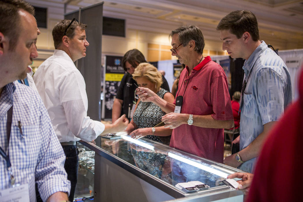 Kevin Prochaska, center right, inquires about a watch at Pawn Expo at The Mirage on Wednesday, July 12, 2017.  Patrick Connolly Las Vegas Review-Journal @PConnPie