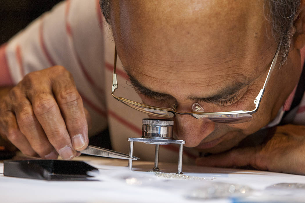 An employee of JP Diamond Manufacturers, Inc., who declined to give his name, examines diamonds at Pawn Expo at The Mirage on Wednesday, July 12, 2017.  Patrick Connolly Las Vegas Review-Journal @ ...