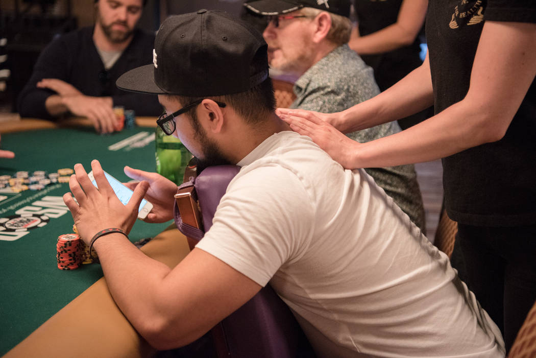 Professional Massage employee Erica Nelson massages Ryan Tosoc at WSOP on Wednesday, July 12, 2017, at Rio Convention Center in Las Vegas. Morgan Lieberman Las Vegas Review-Journal