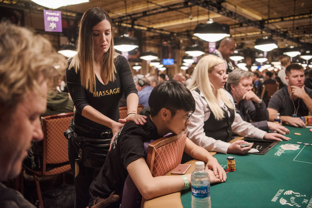 Professional Massage employee Yisell del Campo massages Zheng Yu at WSOP on Wednesday, July 12, 2017, at Rio Convention Center in Las Vegas. Morgan Lieberman Las Vegas Review-Journal