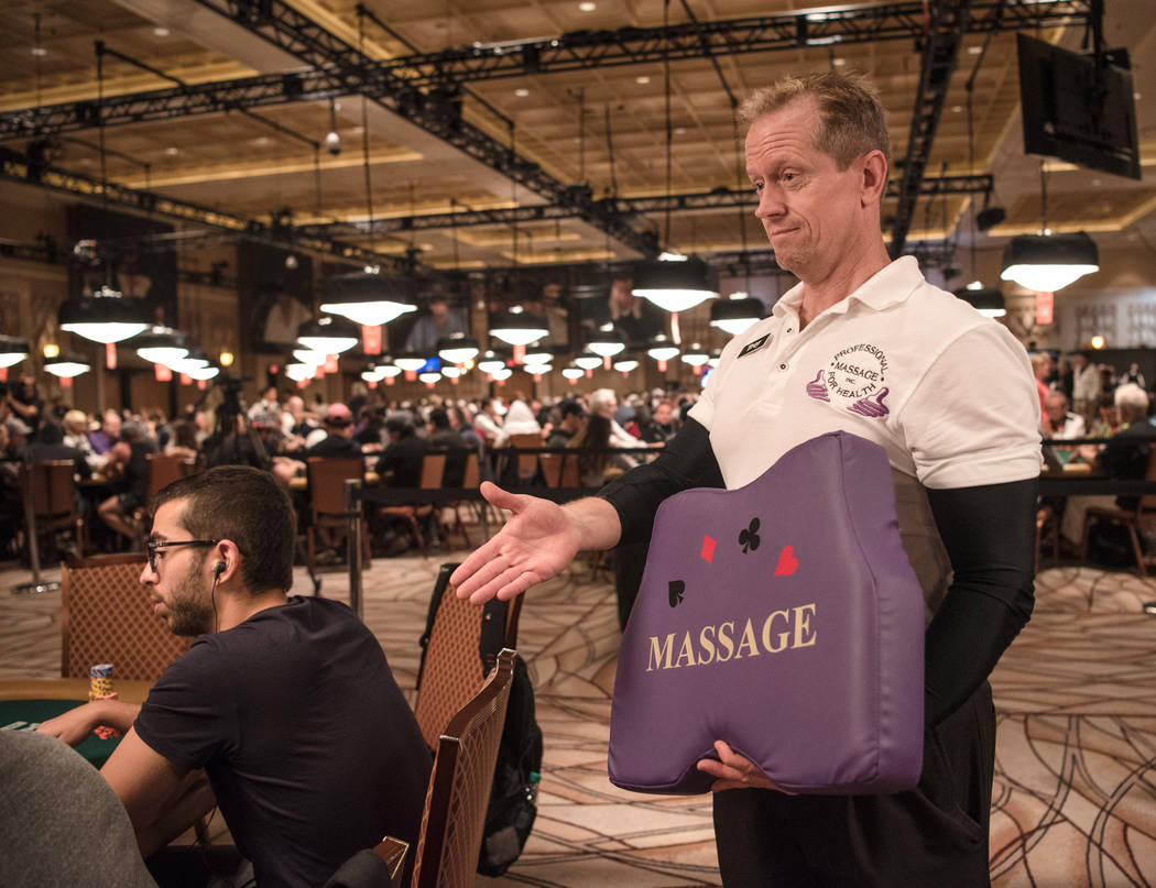 Professional Massage employee Troy Miller makes his rounds at the poker tables at WSOP on Wednesday, July 12, 2017, at Rio Convention Center in Las Vegas. Morgan Lieberman Las Vegas Review-Journal