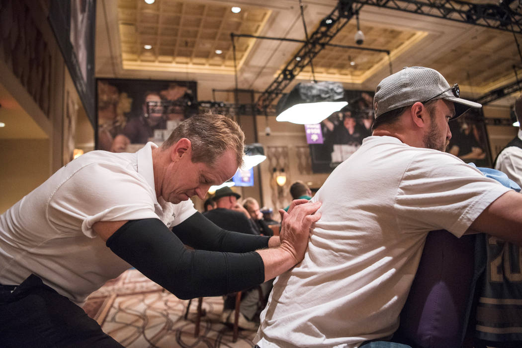 Professional Massage employee Troy Miller gives a massage to Florida resident Daniel Pearlman at WSOP on Wednesday, July 12, 2017, at Rio Convention Center in Las Vegas. Morgan Lieberman Las Vegas ...