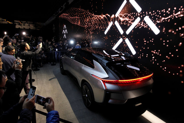 Journalists gather around a Faraday Future FF 91 electric car during an unveiling event at CES in Las Vegas, Nevada, January 3, 2017. (Steve Marcus/Reuters)