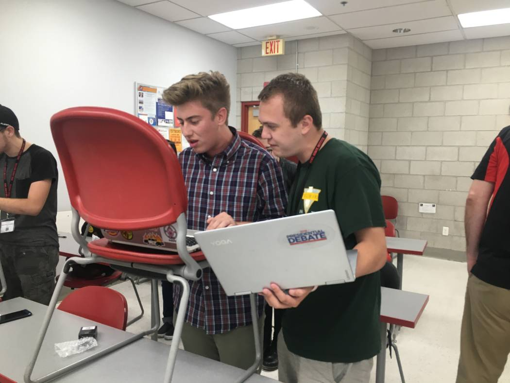 Lab leader Matt Gomez helps Alex Shelton, 17, speed read at the Rebel Debate Institute on July 12, 2017. (Bailey Schulz/Las Vegas Review-Journal)