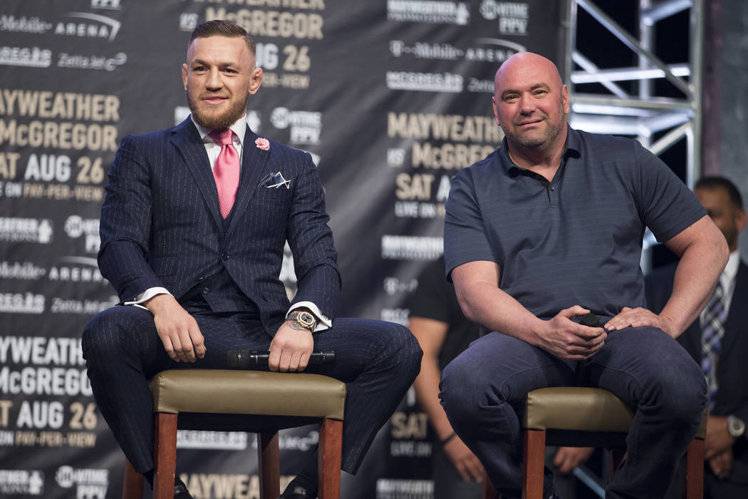 Mixed Martial Artist fighter Conor McGregor, left, and UFC president Dana White during a world tour event stop to promote his upcoming fight against Boxer Floyd Mayweather Jr., at Staples Center i ...