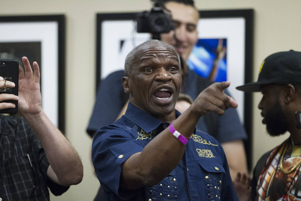 Floyd Mayweather Sr., heckles the press conference by UFC fighter Conor McGregor, not pictured, during a world tour event stop to promote his son's upcoming fight against McGregor, at Staples Cent ...