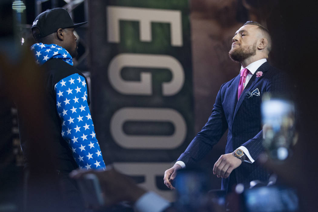 Boxer Floyd Mayweather Jr., left, and UFC fighter Conor McGregor, during a press conference in their world boxing tour to promote their upcoming fight, at Staples Center in Los Angeles, Calif., on ...