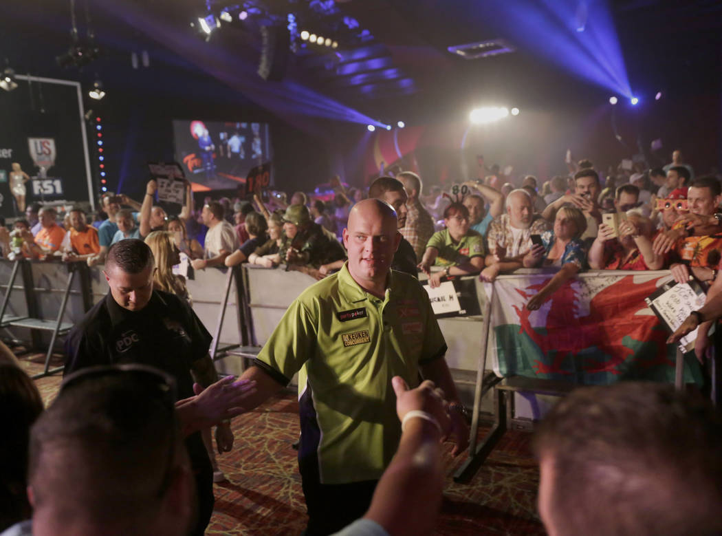 Michael van Gerwen greets fans before his semifinal against Gerwyn Price during day two of PDC's U.S. Darts Masters at The Tropicana Las Vegas in  Las Vegas, Saturday, July 15, 2017. Gabriella Ang ...