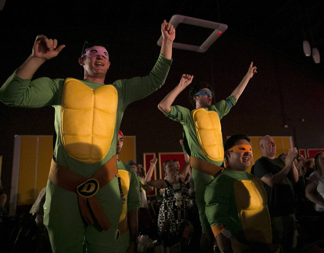 "A group of friends who asked to be called ""The Ninja Turtles"" cheer during day two of PDC's U.S. Darts Masters at The Tropicana Las Vegas in  Las Vegas, Saturday, July 15, 2017.  ..."