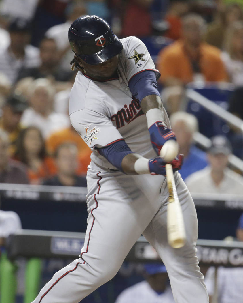 American League's Minnesota Twins Miguel Sanó hits an RBI which scores a run in the fifth inning, during the MLB baseball All-Star Game, Tuesday, July 11, 2017, in Miami. (AP Photo/Lynne Sladky)