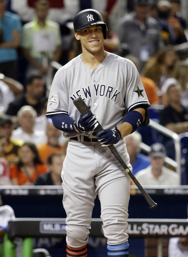 American League's New York Yankees Aaron Judge (99), smiles in between pitches in the fifth inning, during the MLB baseball All-Star Game, Tuesday, July 11, 2017, in Miami. (AP Photo/Lynne Sladky)