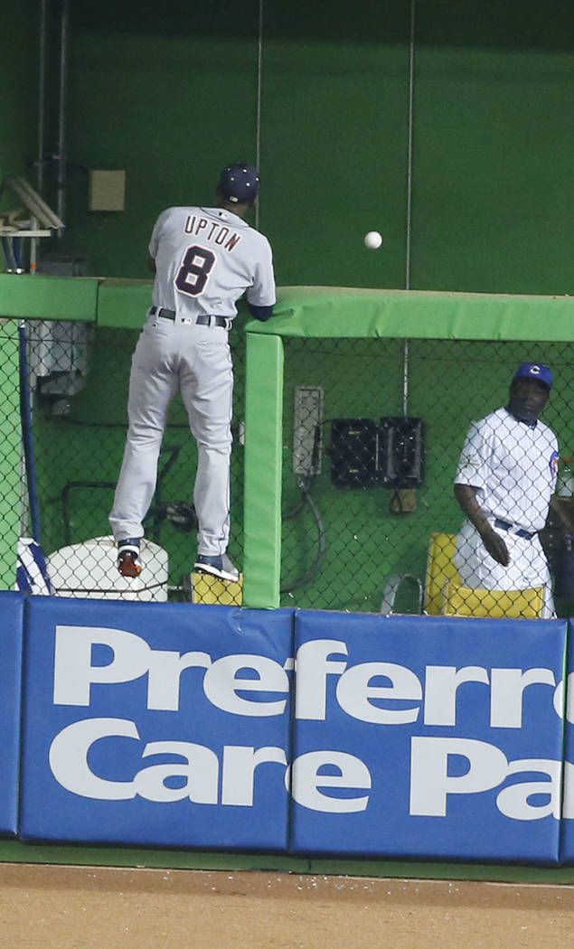 American League Detroit Tigers outfielder Justin Upton (8), looks at St. Louis Cardinals Molina's home run in the sixth inning, at the MLB baseball All-Star Game, Tuesday, July 11, 2017, in Miami. ...